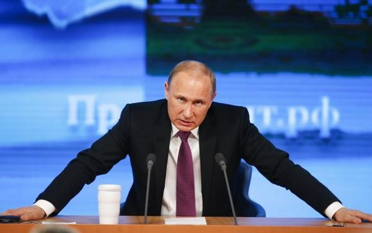 Russian President Vladimir Putin speaks during his annual end-of-year news conference in Moscow, December 18, 2014. REUTERS/Maxim Zmeyev