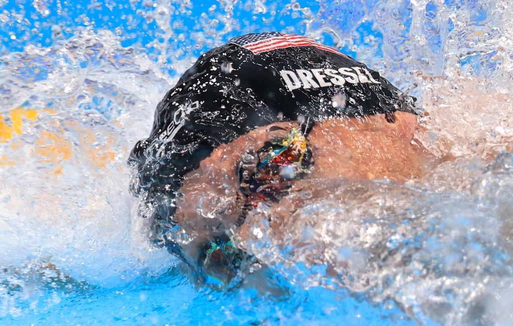 Olympic Tokyo 2020  Kỷ lục liên tiếp bị phá trên làn đua xanh - Ảnh 1.