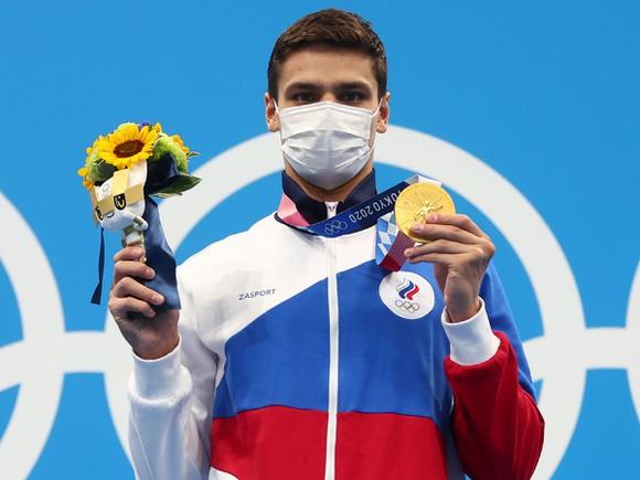 Olympic Tokyo 2020  Kỷ lục liên tiếp bị phá trên làn đua xanh - Ảnh 2.
