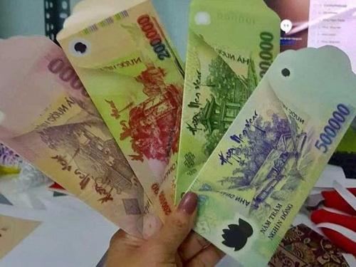 Các bao lì xì in hình tiền giống như thật có thể bị phạt rất nặng.