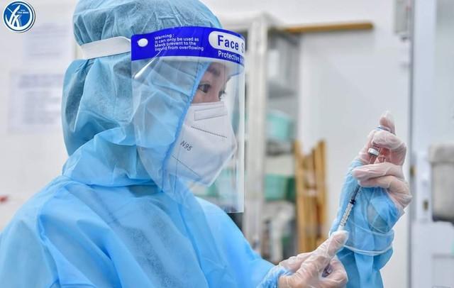 """Bộ Y tế đề nghị TP Hồ Chí Minh làm rõ phản ánh """"đường dây tiêm vaccine thu phí"""" - Ảnh 1."""