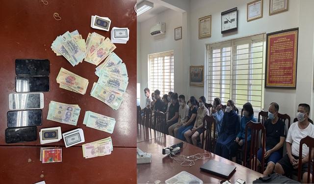 Bắt giữ 13 người đang tự tập đánh bạc giữa lúc Hà Nội giãn cách xã hội - Ảnh 2.