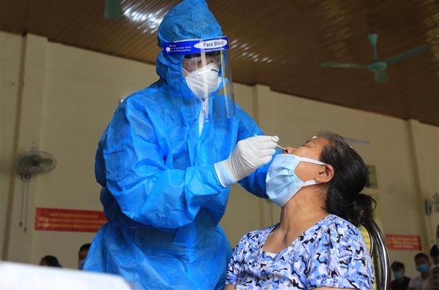 Bộ Y tế đã hướng dẫn Sở Y tế TP HCM cập nhật số liệu ca F0 qua xét nghiệm bằng test nhanh từ ngày 20/8 - Ảnh 1.