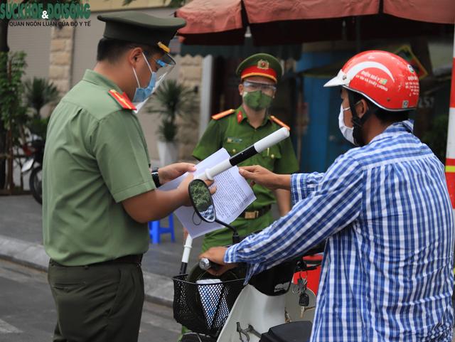 Công an Hà Nội hướng dẫn quy trình xét duyệt, cấp Giấy đi đường cho 6 nhóm đối tượng tại Vùng 1 - Ảnh 2.