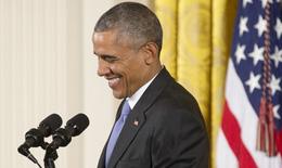 Khi Obama nói chuyện vui vẻ với Chủ tịch Cuba, thế giới đã đổi thay